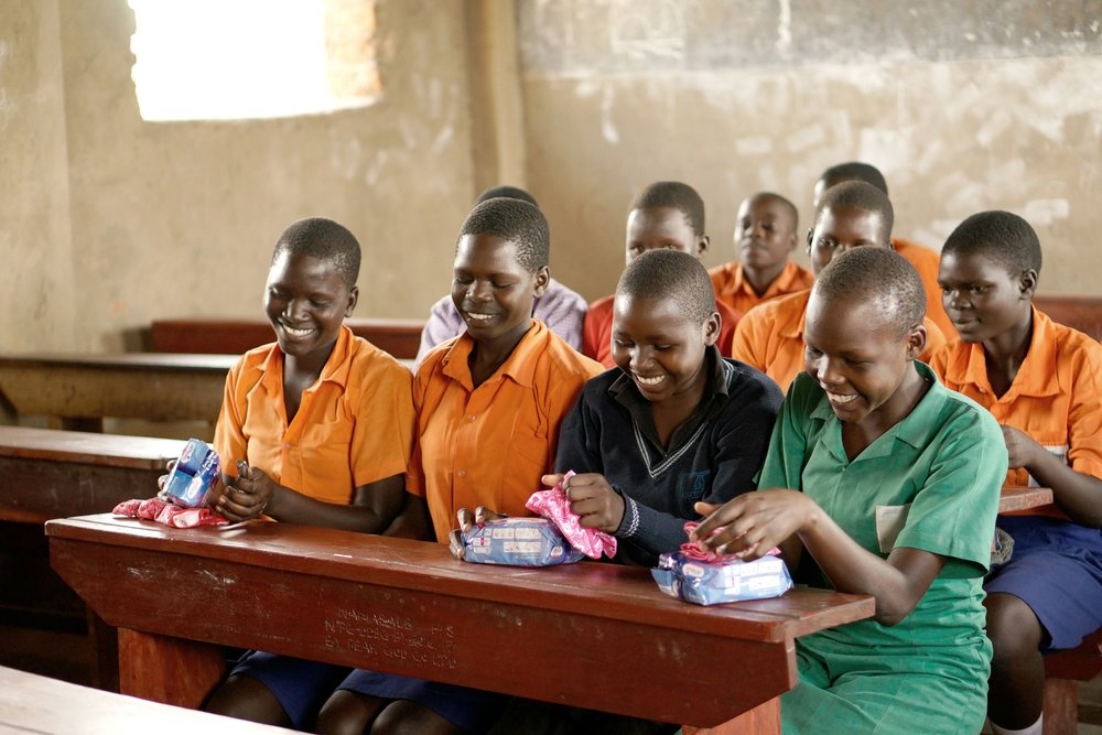 Students at Namasale Primary School receiving feminine hygiene kits from AfriPads as part of our School Outreach Program