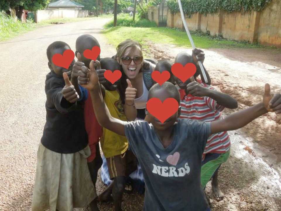 Here I am at 19 on my first volunteer trip abroad, posing for a photo with kids I didn't really know.