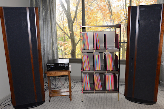 Some of the finest LP racks made: WAX RAX (Owner David Stanavich). The elegant way they used one of their racks between the speakers was most attractive (unknown price). The amp is the Tavish Design LLC Minataur ($2750).