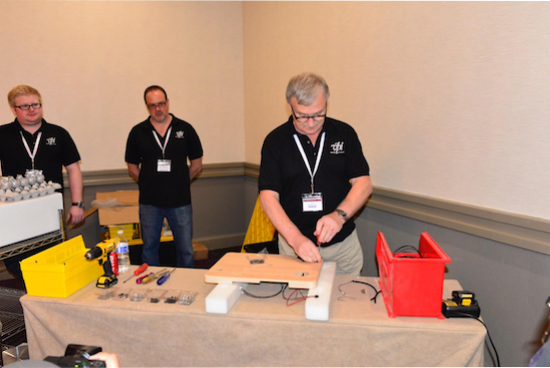 VPI technicians gave a demonstration of how to actually build a Nomad Turntable; a large crowd came by to see.
