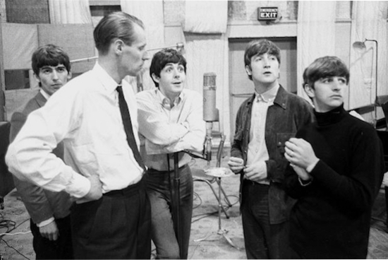 The Beatles recording at Abbey Road with George Martin.