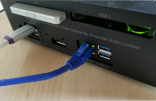 The rear of the unit maintains its simplicity of purpose.  USB, ethernet, power, storage.