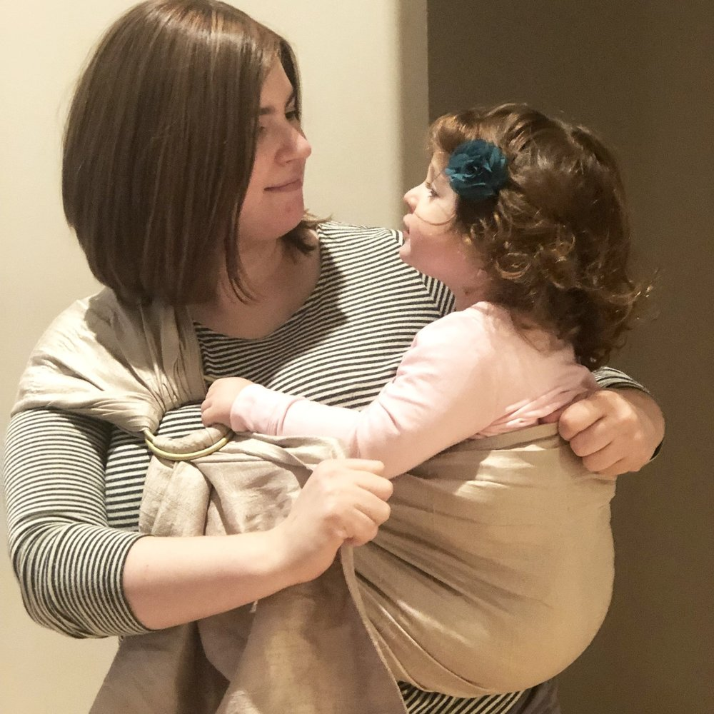 Avie using a ring sling with her toddler