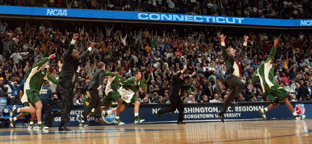 The reaction at the buzzer of George Mason's upset over No. 1 UConn in the Elite Eight. (Getty Images)