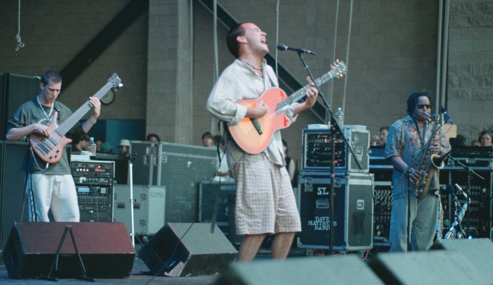 DMB touring for the  Crash  album. From left: Stefan Lessard, Dave Matthews, LeRoi Moore performing at the Blockbuster Pavillion in Los Angeles on July 27, 1996. (Getty Images)