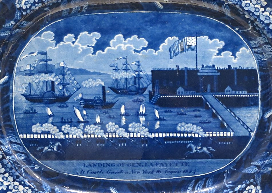 Platter with scene titled  Landing of Gen. Lafayette at Castle Garden, New York, 16th August 1824.  Manufactured by James and Ralph Clews, Staffordshire, England, after a print by Samuel Maverick, c. 1825-30. Glazed earthenware, Dayton Art Institute. Public-domain photo via  Wikimedia Commons.
