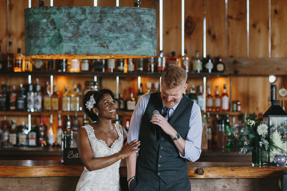 intimate-morning-wedding-farm-south-pond-farms-country-peterborough-ptbo-best-toronto-wedding-photographer-details-reception-bride-and-groom-toast-laughing-speech.jpg