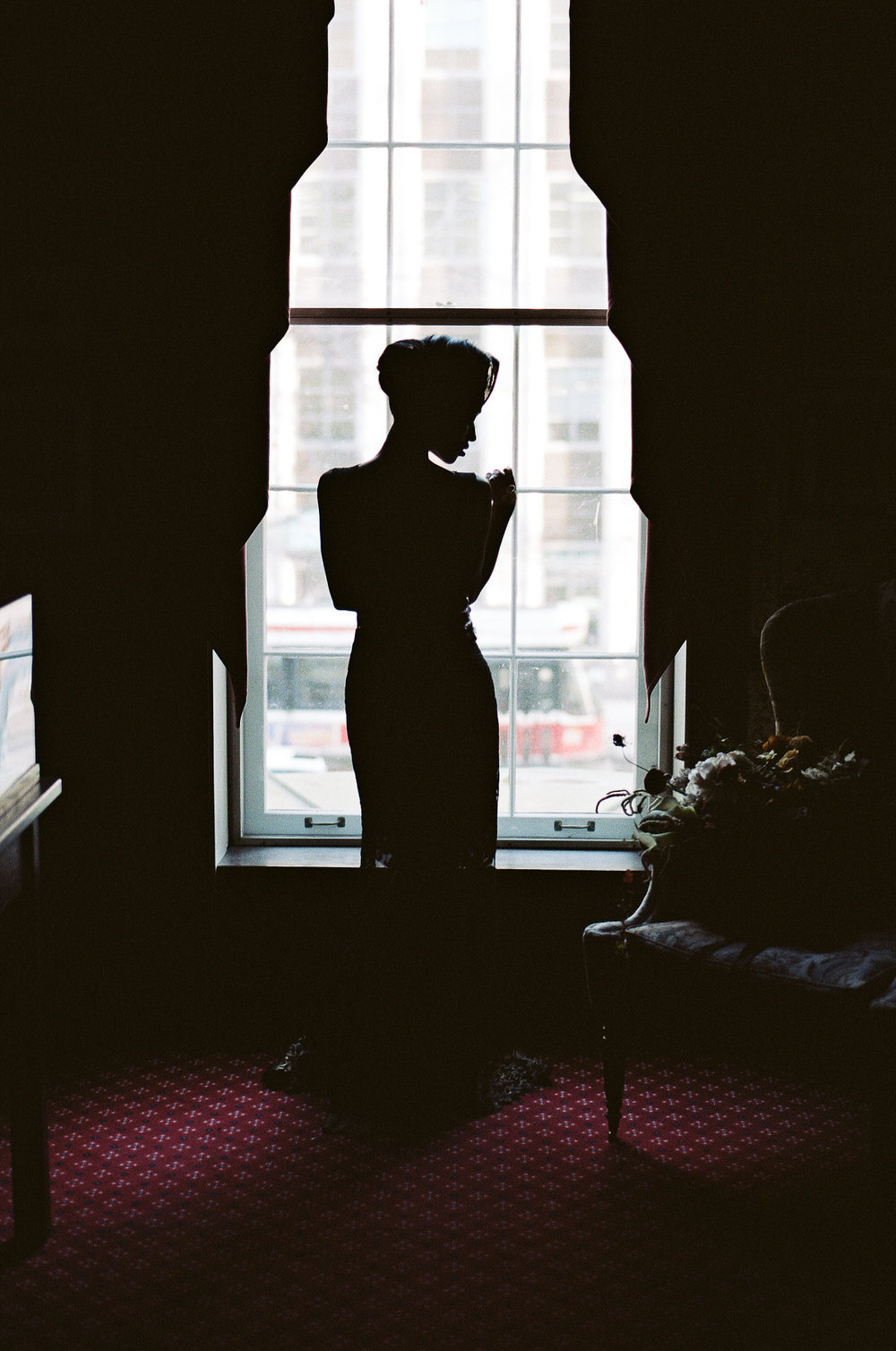 Portra800_645Fuji_15-bride-in-campbell-house-ballroom-high-fashion-narces-gown-black-bride-intimate-beauitful-portrait-silhouetted-bride-downtown-toronto-wedding-mansion.jpg