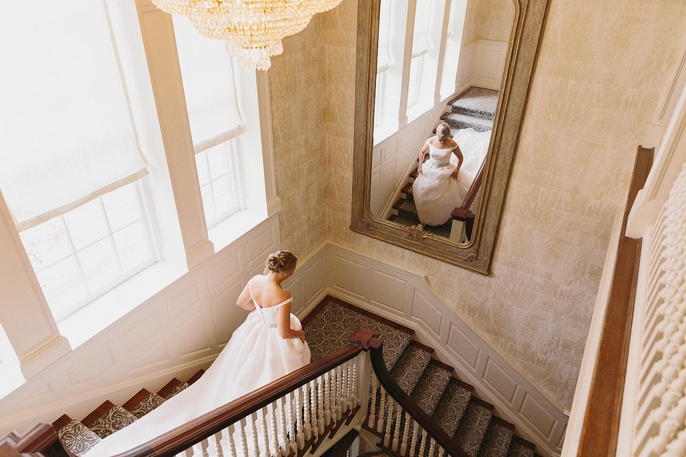 Graydon-Hall-Manor-Wedding-Toronto's-Best-Wedding-Photography-Ryanne-Hollies-Intimate-Small-Modern-Colourful-Wedding-Bride-Getting-Ready-Ferre-Sposa-Gown-bridal-portrait-elegant-vintage-bride-grand-hall-staircase.jpg