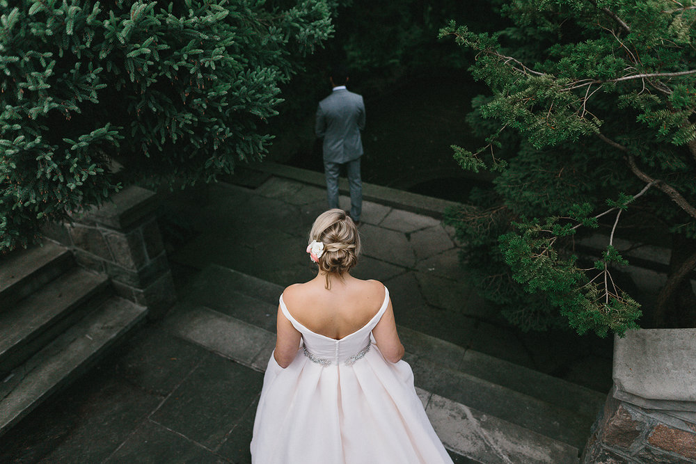 Graydon-Hall-Manor-Wedding-Toronto's-Best-Wedding-Photography-Ryanne-Hollies-Intimate-Small-Modern-Colourful-Wedding-First-Look-on-the-grounds-bride-walking-up-to-groom-dramatic-candid.jpg