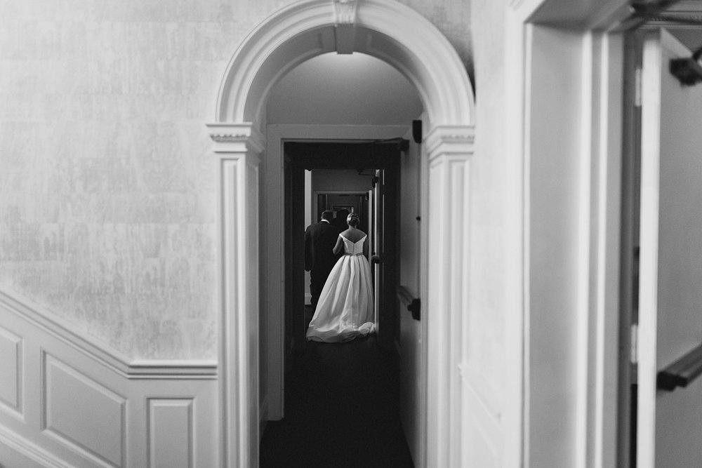 Graydon-Hall-Manor-Wedding-Toronto's-Best-Wedding-Photography-Ryanne-Hollies-Intimate-Small-Modern-Colourful-brunch-wedding-ceremony-bride-and-father-walking-down-the-aisle-candid-moody.jpg