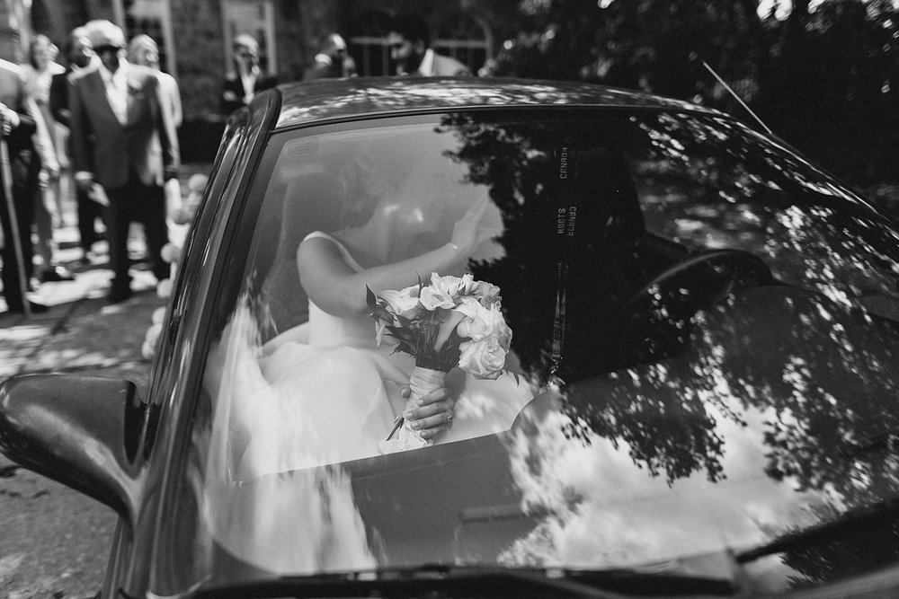 Graydon-Hall-Manor-Wedding-Toronto's-Best-Wedding-Photography-Ryanne-Hollies-Intimate-Small-Modern-Colourful-brunch-wedding-reception-bride-and-groom-mixed-wedding-recessional-formal-exit-in-car.jpg