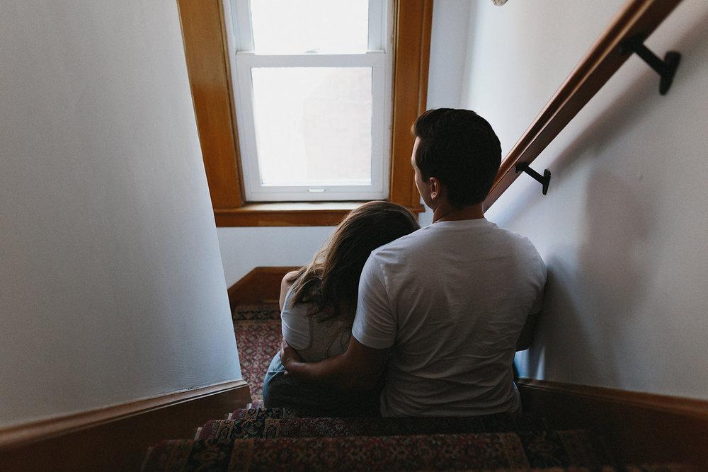 hamilton-toronto-inhome-maternity-session-toronto-maternity-photographer-ryanne-hollies-photography-candid-documentary-lifestyle-session-hallway-stairwell-sitting-embrace.jpg