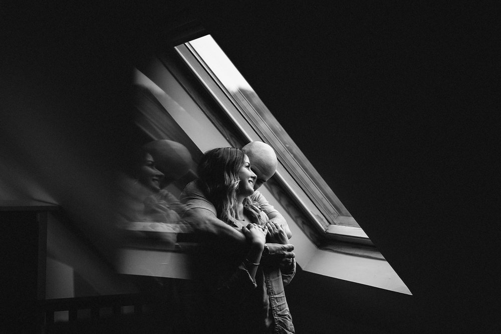 downtown-toronto-in-home-engagement-session-toronto-wedding-photographer-ryanne-hollies-photography-documentary-candid-natural-photos-engaged-in-toronto-alternative-modern-couple-cuddling-intimate-fun-laughing.jpg