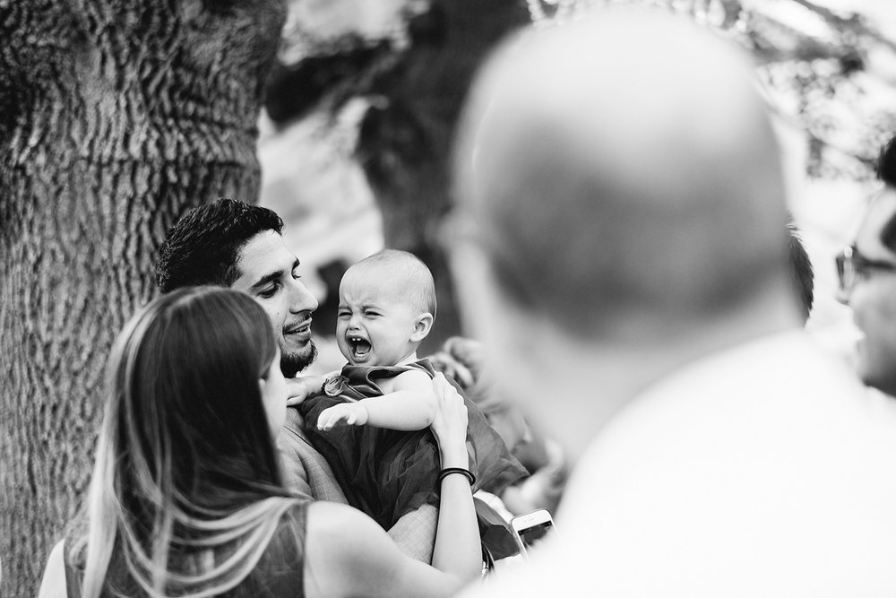 Graydon-Hall-Manor-Wedding-Toronto's-Best-Wedding-Photography-Ryanne-Hollies-Intimate-Small-Modern-Colourful-Wedding-reception-guests-candid-groom-with-crying-baby-so-cute.jpg