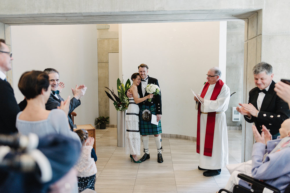 toronto-city-hall-elopement-wedding-old-city-hall-nathan-phillips-square-toronto-wedding-photographer-ryanne-hollies-photography-how-to-elope-in-toronto-civil-ceremony-recessional.jpg