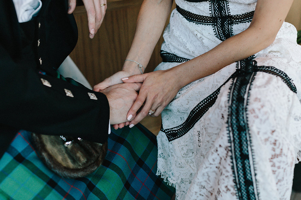 elopement-toronto-city-hall-wedding-documentary-wedding-photography-ryanne-hollies-photography-broadview-hotel-wedding-toronto-best-weding-photographer-hotel-lobby-bar-candid-moments-details-scottish-wedding-hands-wedding-bands.jpg