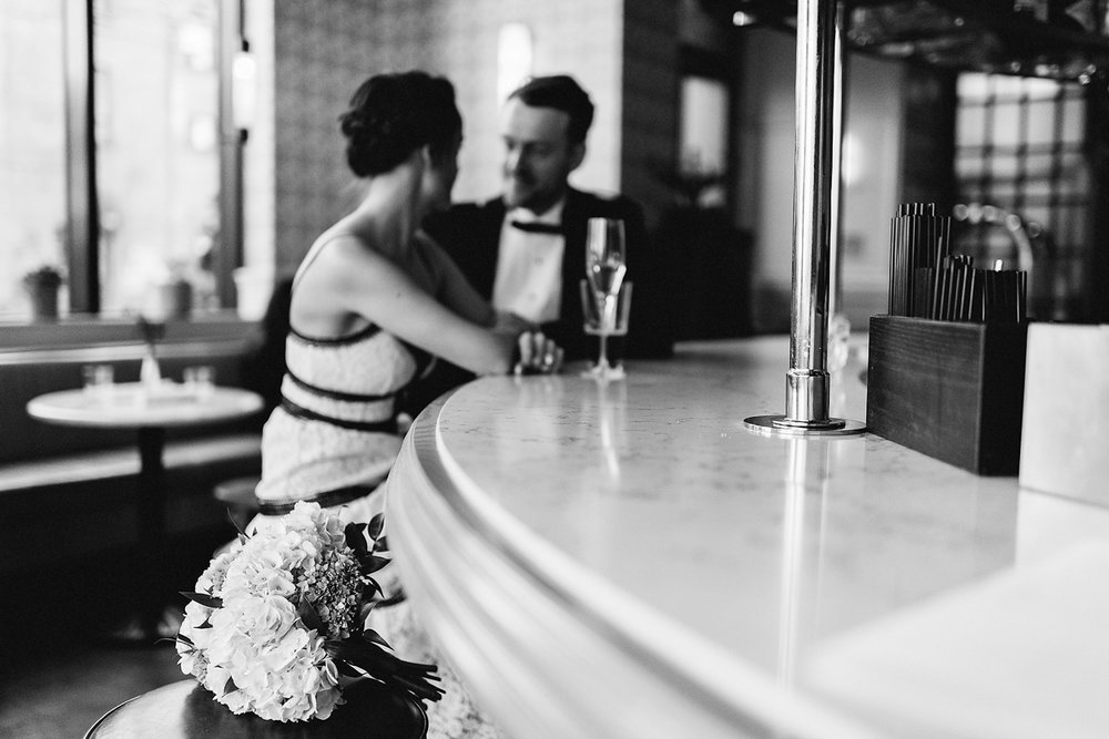 elopement-wedding-toronto-wedding-photographer-ryanne-hollies-photography-how-to-elope-in-toronto-portrait-of-couple-editorial-the-broadview-hotel-room-floor-details-vintage-modern-cafe-lobby-cocktails-bride-and-groom-floral-details.jpg