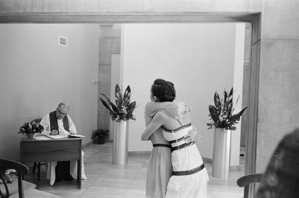 toronto-city-hall-elopement-film-photography-leica-35mm-film-ceremony-vows-toronto-film-wedding-photographer-best-toronto-wedding-photography-sisters.jpg