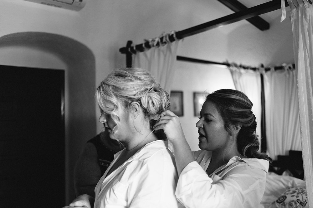 european-wedding-spain-wedding-photographer-destination-wedding-photographer-from-toronto-ryanne-hollies-photography-documentary-editorial-style-toronto-wedding-photographer-getting-ready-bride-and-bridesmaids-helping-her-get-dress.jpg