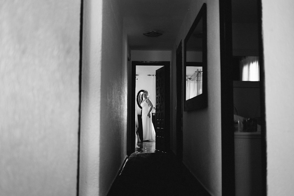 european-wedding-spain-wedding-photographer-destination-wedding-photographer-from-toronto-ryanne-hollies-photography-documentary-editorial-style-toronto-wedding-photographer-getting-ready-bride-candid-moment-in-hallway-portrait.jpg