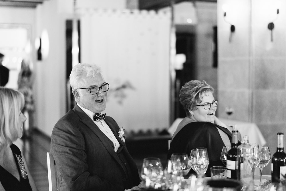 photographer-destination-wedding-photographer-from-toronto-ryanne-hollies-photography-documentary-editorial-style-toronto-wedding-photographer-junebug-weddings-reception-guest-candids-parents-laughing.jpg