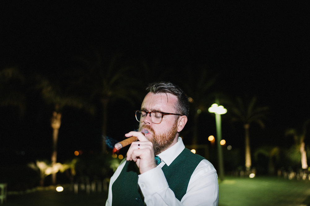 destination-wedding-photographer-from-toronto-ryanne-hollies-photography-documentary-editorial-style-toronto-wedding-photographer-junebug-weddings-reception-partying-candid-moments-grooman-groom-smoking-cigars-cool-hipster-trendy-beards.jpg