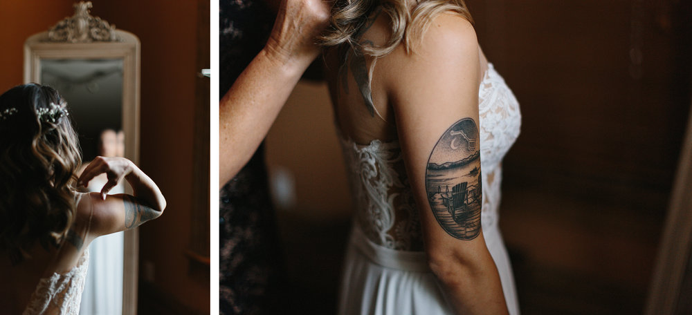 cambium-farms-wedding-toronto-wedding-photographer-ryanne-hollies-photography-gay-wedding-farm-wedding-inspiriration-bride-getting-ready-putting-on-wedding-dress-bw-candid-documetary-tattoed-bride.jpg