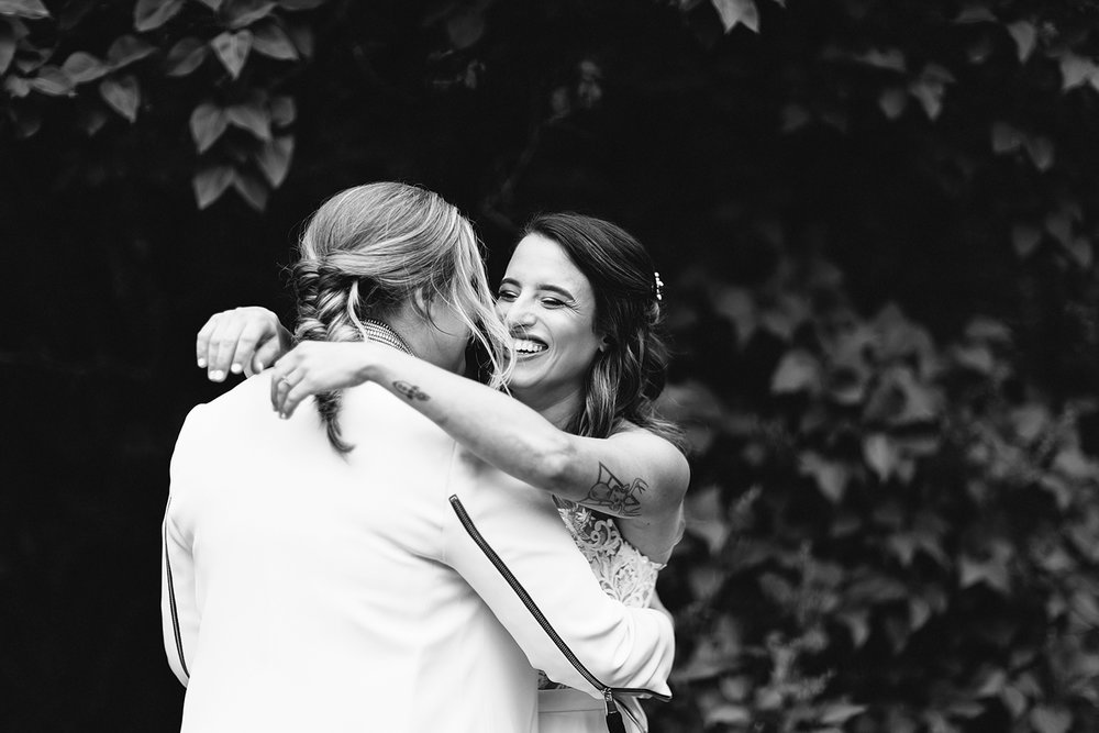 cambium-farms-wedding-toronto-wedding-photographer-ryanne-hollies-photography-gay-wedding-farm-wedding-inspiriration-candid-documetary-tattooed-bride-portrait-first-look-brides-reactions-so-excited-and-happy-emotional-crying-hugging.jpg