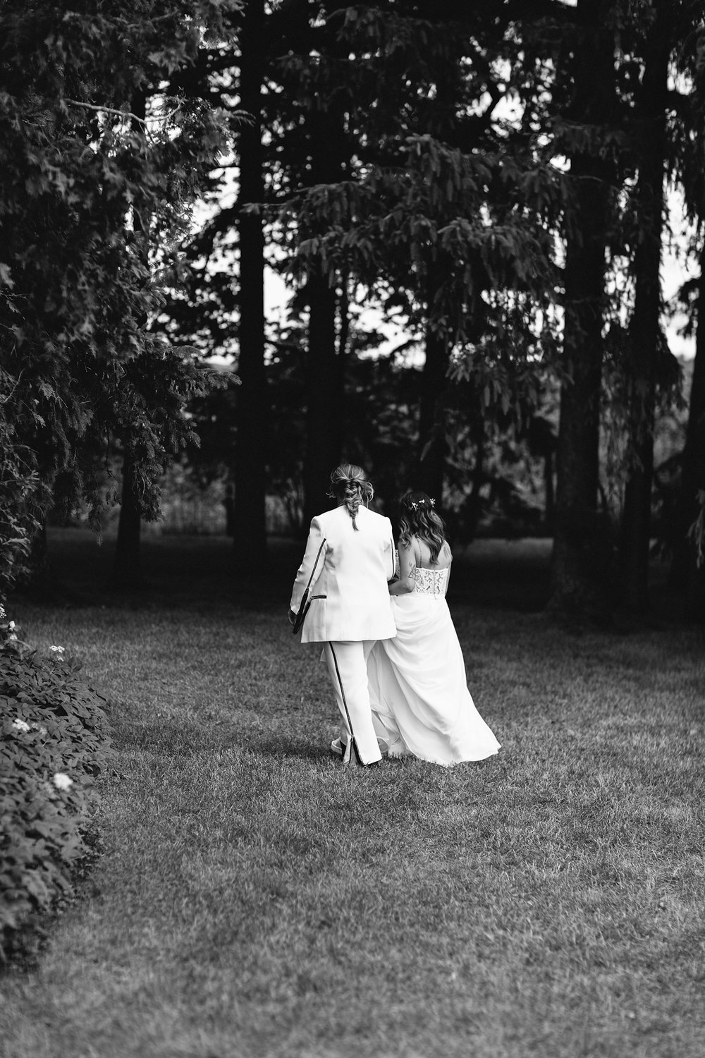 cambium-farms-wedding-ryanne-hollies-photography-gay-wedding-farm-wedding-inspiriration-green-wedding-shoes-couples-portraits-rustic-barn-vintage-trendy-badass-couple-gay-wedding-walking-away-bw.jpg