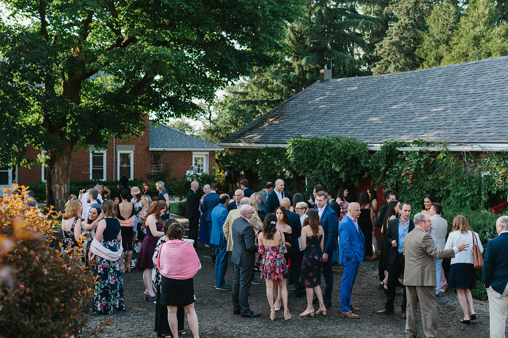 cambium-farms-wedding-ryanne-hollies-photography-gay-wedding-lgbtq-trendy-cool-badass-junebug-weddings-inspiration-cocktail-hour--candid-documentary-moments-all-guests.jpg