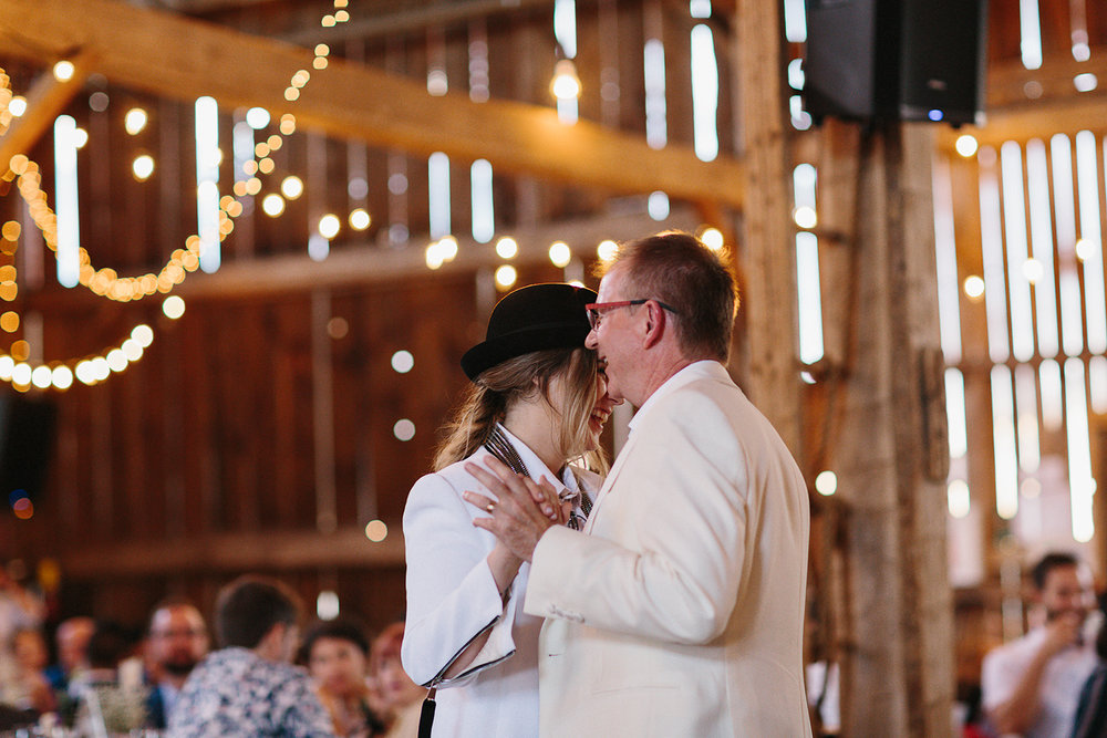cambium-farms-wedding-ryanne-hollies-photography-gay-wedding-lgbtq-trendy-cool-badass-junebug-weddings-inspiration-wedding-reception-in-a-barn-father-and-daughter-dance.jpg