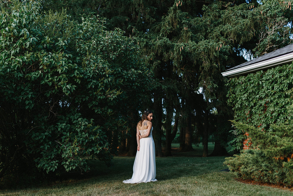 cambium-farms-wedding-ryanne-hollies-photography-gay-wedding-lgbtq-trendy-cool-badass-junebug-weddings-inspiration-cocktail-hour--candid-documentary-moments-farm-sunset-bridal-portrait-simple-beautiful-editorial-golden-hour-blu-ivy-dress.jpg