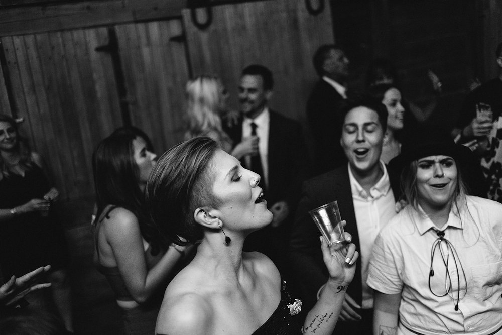 cambium-farms-ryanne-hollies-photography-gay-wedding-lgbtq-trendy-cool-badass-junebug-weddings-inspiration-wedding-reception-huge-party-candid-fun-moments-memories-friends-dancing.jpg