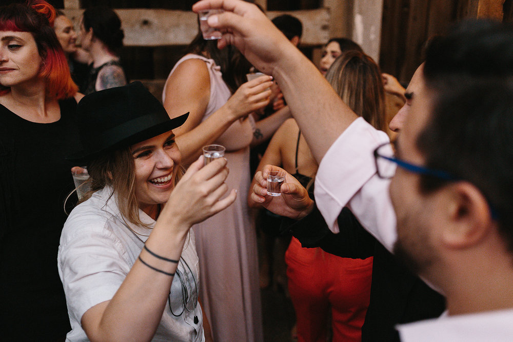cambium-farms-ryanne-hollies-photography-gay-wedding-lgbtq-trendy-cool-badass-junebug-weddings-inspiration-wedding-reception-huge-party-candid-fun-moments-memories-shots-with-the-bride.jpg