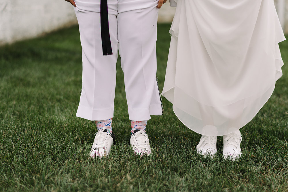 cambium-farms-wedding-ryanne-hollies-photography-gay-wedding-farm-wedding-inspiriration-green-wedding-shoes-couples-portraits-rustic-barn-vintage-trendy-badass-couple-intimate-romantic-details-socks-platform-sneakers.jpg