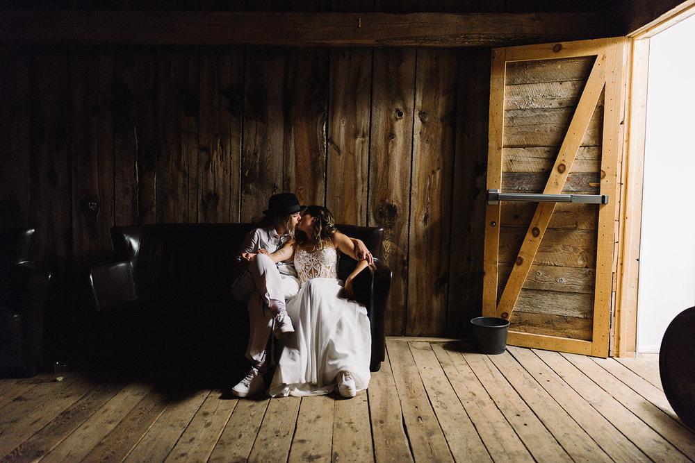 cambium-farms-ryanne-hollies-photography-gay-wedding-lgbtq-trendy-cool-badass-junebug-weddings-inspiration-wedding-reception-huge-party-candid-fun-moments-bride-and-bride-night-portrait-kiss-goodnight.jpg