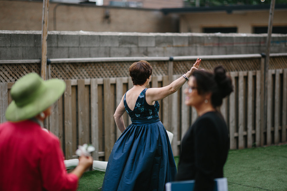 downtown-toronto-wedding-photographer-ryanne-hollies-photography-airship37-distillery-district-wedding-day-modern-minimalist-venues-in-toronto-cool-trendy-hipster-party-bus-outdoor-patio-graffiti-groom-greeting-guests-moments-waving.jpg