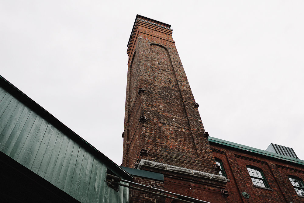 wedding-photographers-ryanne-hollies-photography-fine-art-photojournalism-artistic-moody-creative-inspiration-downtown-toronto-airship37-distillery-district-details-old-toronto-brick-buildings-smoke-stacks.jpg