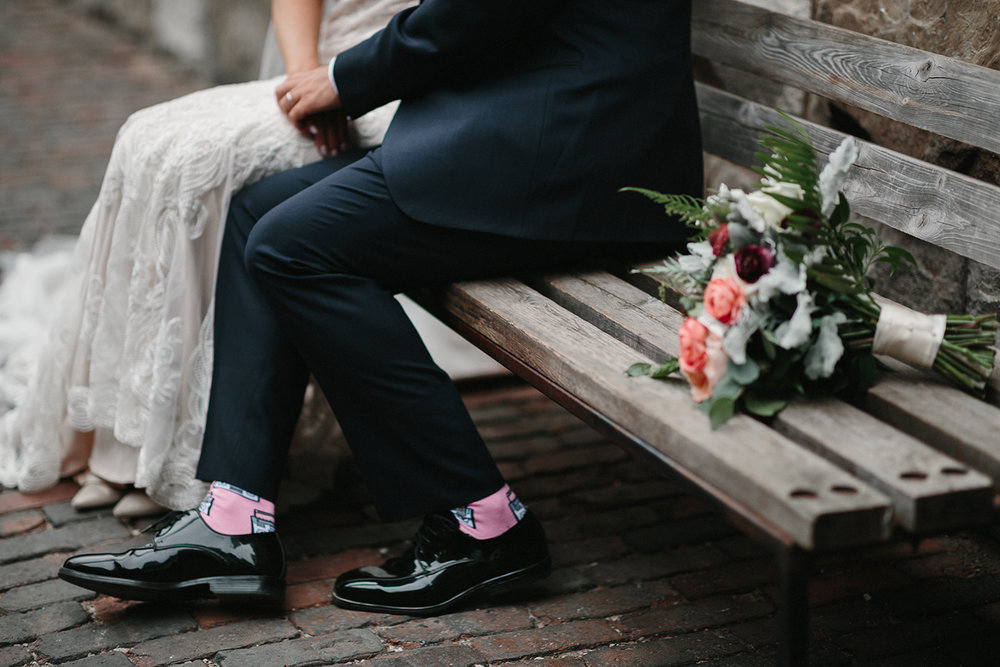 torontos-best-documentary-wedding-photographers-ryanne-hollies-photography-fine-art-photojournalism-artistic-moody-toronto-airship37-distillery-district-groom-and-bride-poratraits-intimate-authentic-film-analog-photography-grooms-socks.jpg