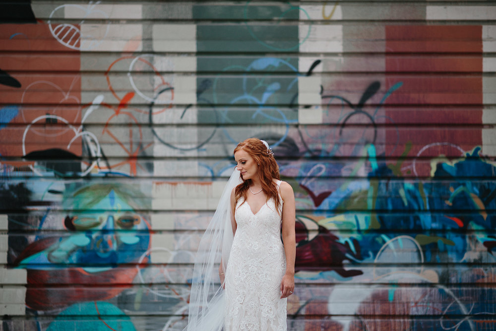 torontos-best-wedding-photographers-ryanne-hollies-photography-photojournalism-artistic-moody-toronto-airship37-graffiti-editorial-magazine-fashion-inspiration-bride-portrait-vintage-lace-dress-artistic-veil.jpg