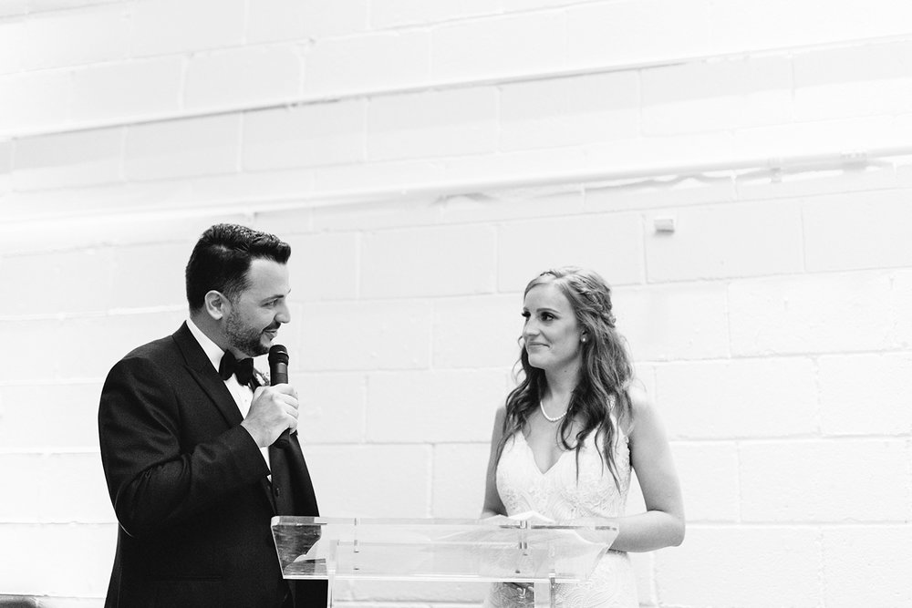 torontos-best-wedding-photographers-ryanne-hollies-photography-photojournalism-artistic-moody-toronto-airship37-graffiti-editorial-reception-bride-and-groom-speech-cheers-grooms-speech-to-wife-honest-emotional-sincere.jpg
