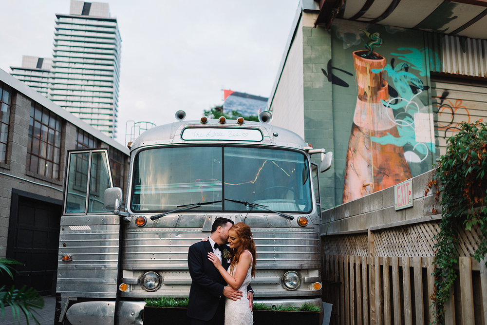 torontos-best-wedding-photographers-ryanne-hollies-photography-photojournalism-artistic-moody-toronto-airship37-graffiti-editorial-reception-outdoor-details-sunset-urban-portrait-intimate-epic-with0bus.jpg