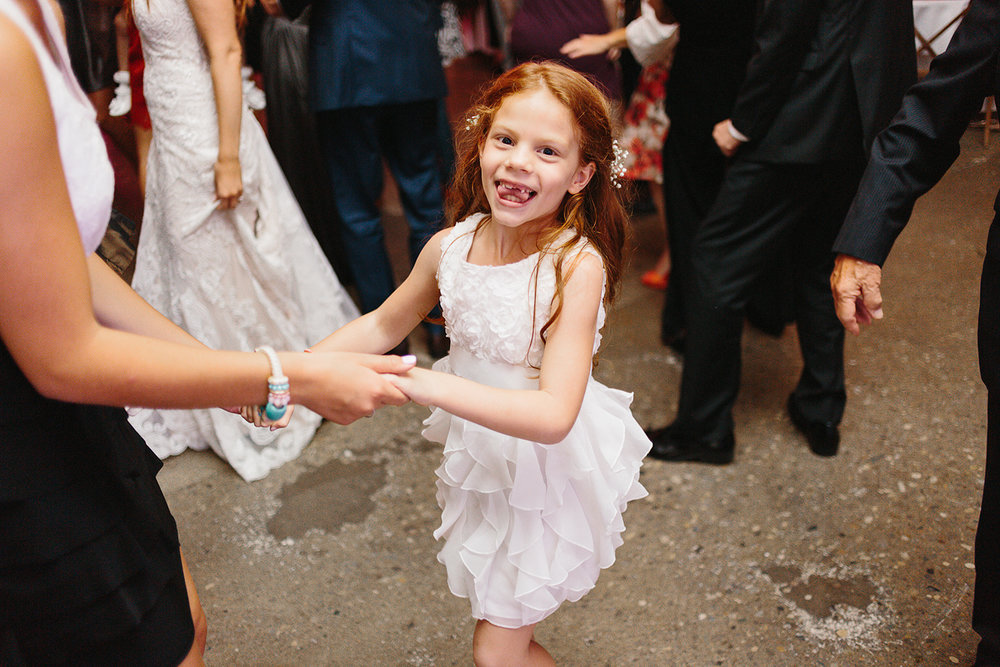 torontos-best-wedding-photographers-ryanne-hollies-photography-photojournalism-artistic-moody-toronto-airship37-graffiti-editorial-reception-dancing-together-fun-flower-girl-so-cute.jpg