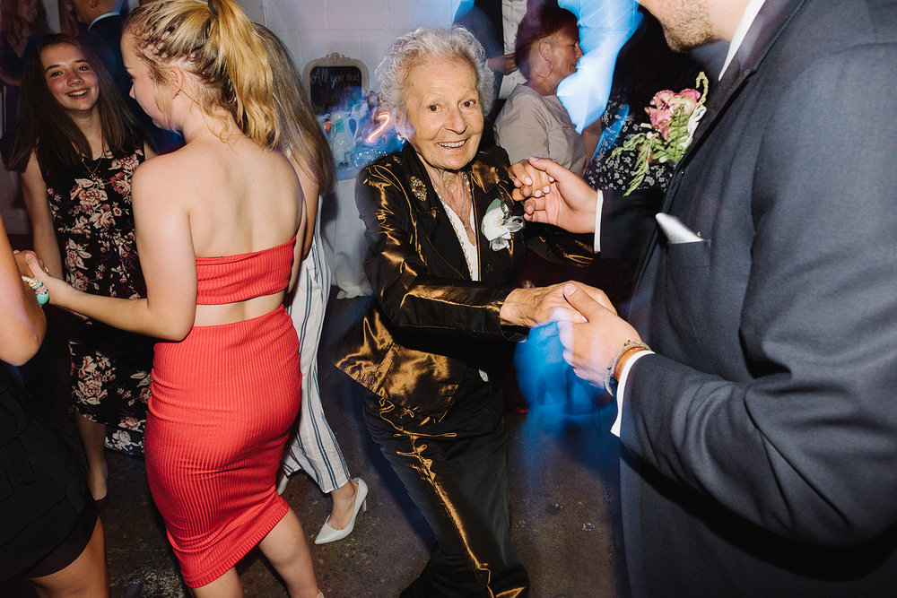 torontos-best-wedding-photographers-ryanne-hollies-photography-photojournalism-artistic-moody-toronto-airship37-graffiti-editorial-reception-dancing-together-hilarious-good-times-memories-grandma-dancing.jpg