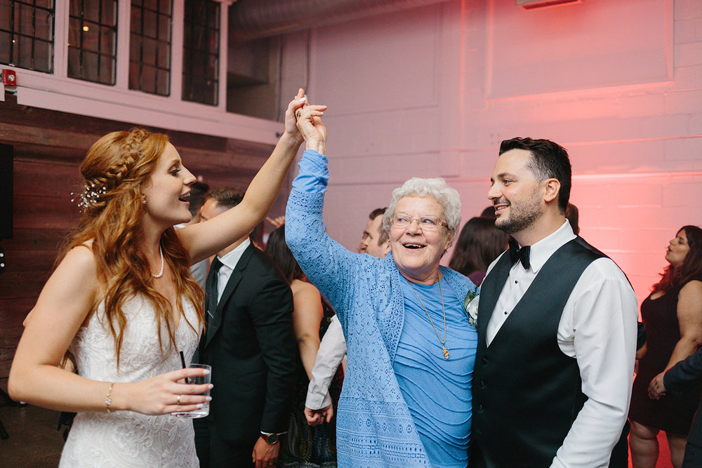 torontos-best-wedding-photographers-ryanne-hollies-photography-photojournalism-artistic-moody-toronto-airship37-graffiti-editorial-reception-dancing-together-hilarious-good-times-memories-bride-and-groom-with-grandma-sweet.jpg