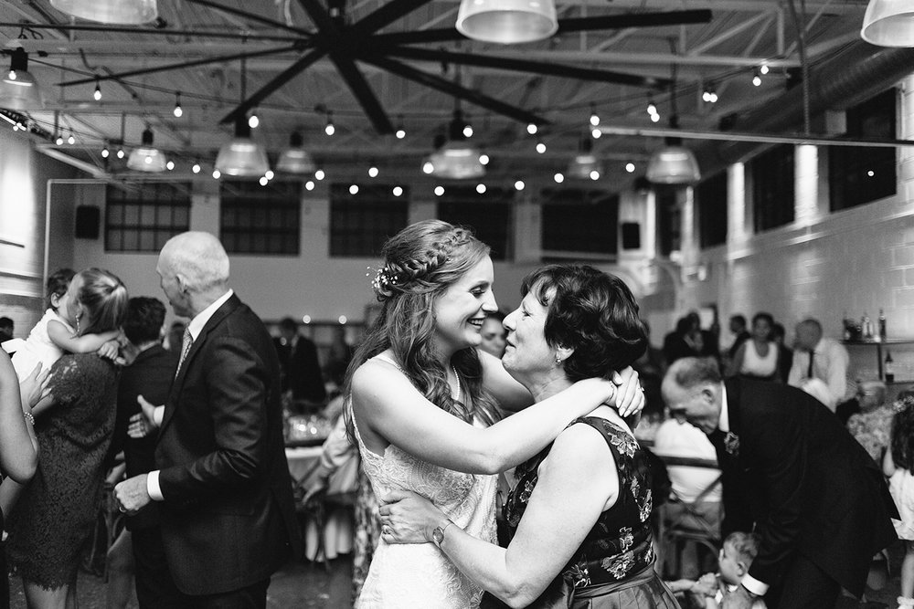 torontos-best-wedding-photographers-ryanne-hollies-photography-photojournalism-artistic-moody-toronto-airship37-graffiti-editorial-reception-bride-and-mom-dancing-together.jpg