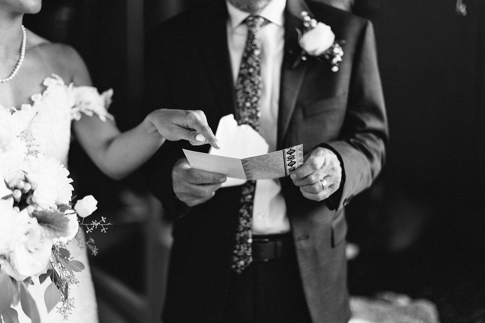 muskoka-wedding-photographer-toronto-wedding-photography-hidden-valley-resort-documentary-photojournalistic-fine-art-wedding-photography-getting-ready-bride-first-look-with-dad-sentimental-moments-bw-giving-gift.jpg