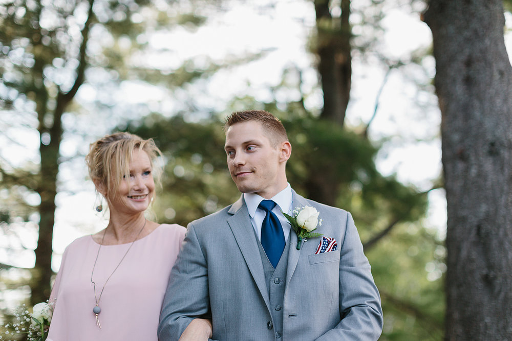 muskoka-wedding-photographer-toronto-wedding-photography-hidden-valley-resort-documentary-photojournalistic-fine-art-wedding-photography-lakeside-ceremony-cottage-country-groom-walking-mom-down-the-aisle.jpg