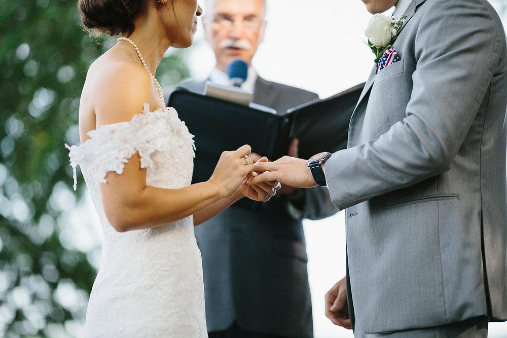Graydon-Hall-Manor-Wedding-Toronto's-Best-Wedding-Photography-Ryanne-Hollies-Intimate-Small-Modern-Colourful-Wedding-Bride-Getting-Ready-Ferre-Sposa-Gown-bride-putting-wedding-dress-pre-wedding-ceremony-looking-at-guests.jpg
